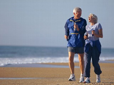 walking couple on the beach - massage therapy